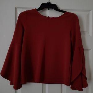 Long, open sleeve rust blouse